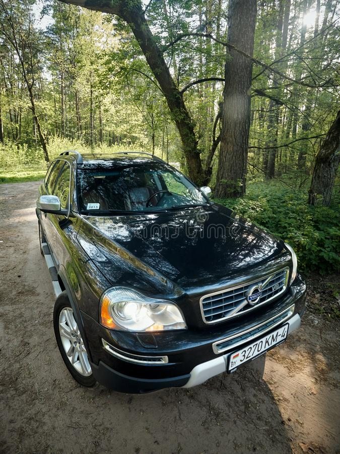 Volvo XC90 4.4 v8 1st generation restyling 4WD SUV test drive in spring forest country road wide shot side vertical view royalty free stock image