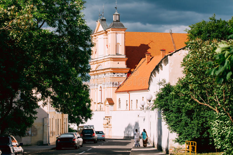 Grodno, Belarus. People Walking Near Catholic Church Of The Annunciation Of The Blessed Virgin Mary And A Bridgettine stock photo