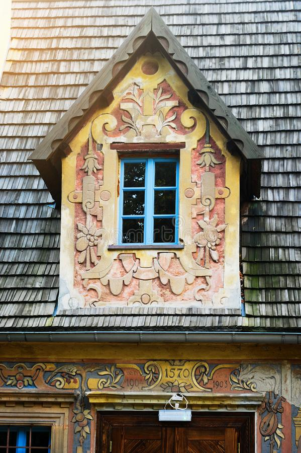 Grodno Castle in Zagorze Slaskie, Lower Silesia, Poland. Gable fronted dormer window and wooden shingle roof on gatehouse building. Grodno Castle formerly royalty free stock image