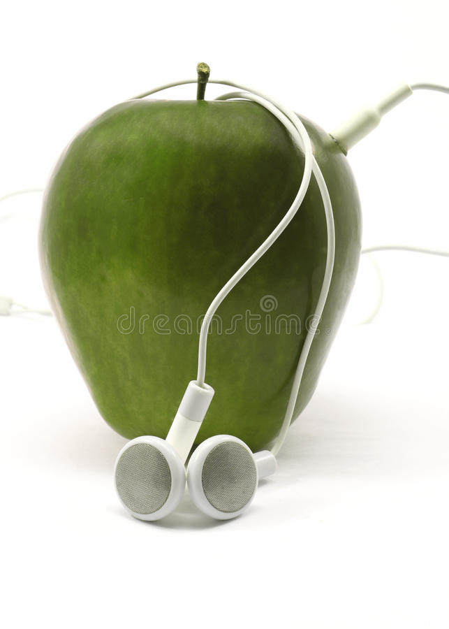 Groen Apple met Earbuds stock afbeelding