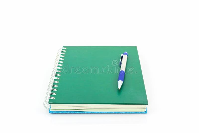 Groen boek met pen royalty-vrije stock fotografie