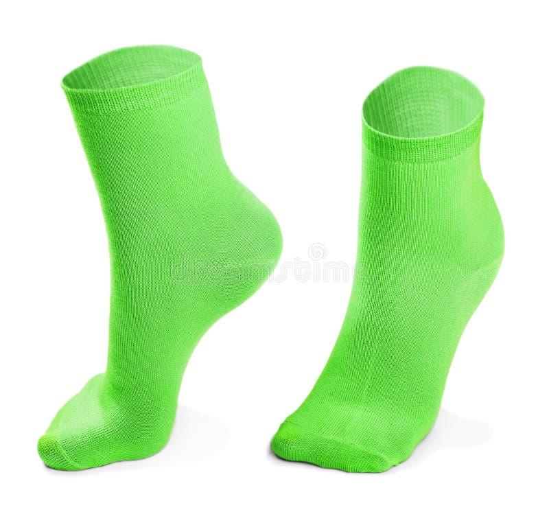 Groen die paar sokken op witte achtergrond wordt geïsoleerd royalty-vrije stock foto's