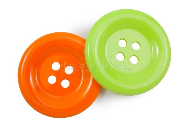 Groen en Sinaasappel clasper stock afbeelding