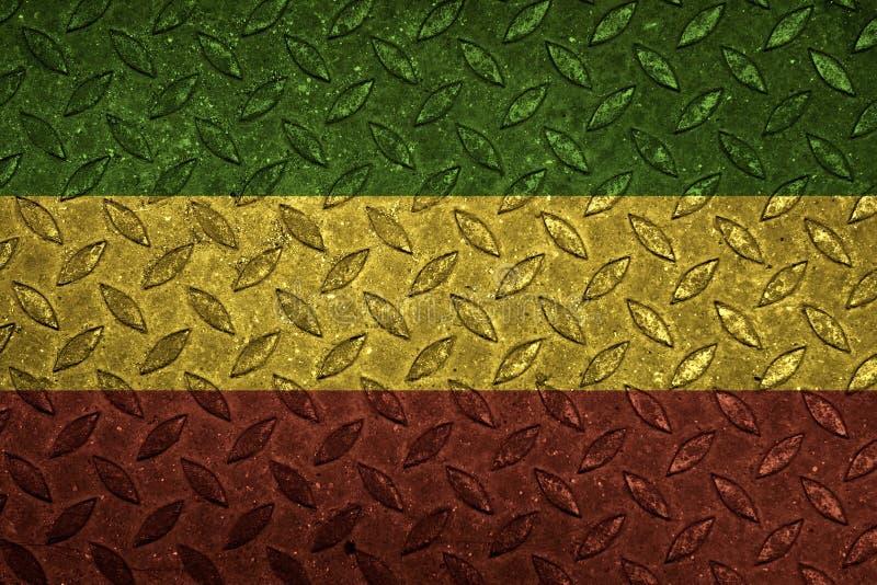 Groen geel rood op staalplaat, reggae achtergrondconcept stock foto's