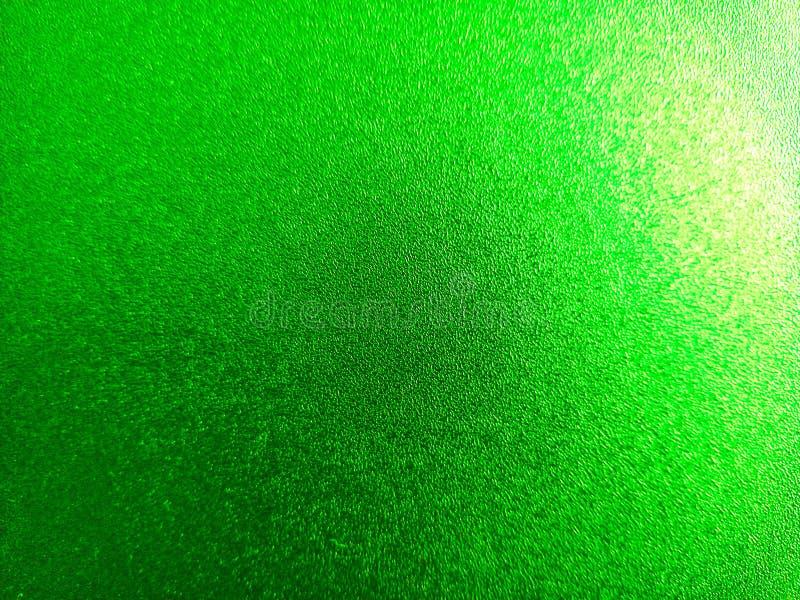 Groen gekleurde glanzende achtergrond met lichte en donkere lichteffecten, aantrekkelijk behangpapier stock foto's