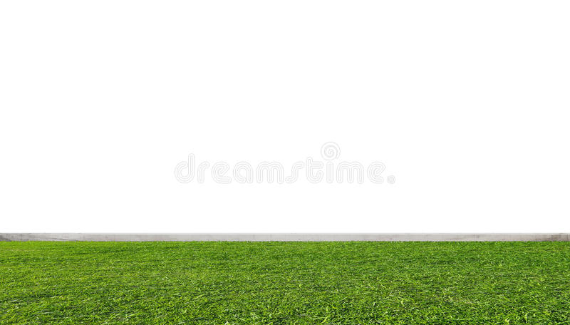 Groen grasgazon, met witte muur stock foto