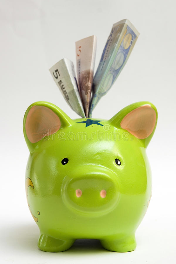 Groen Spaarvarken En Geld Royalty-vrije Stock Foto's