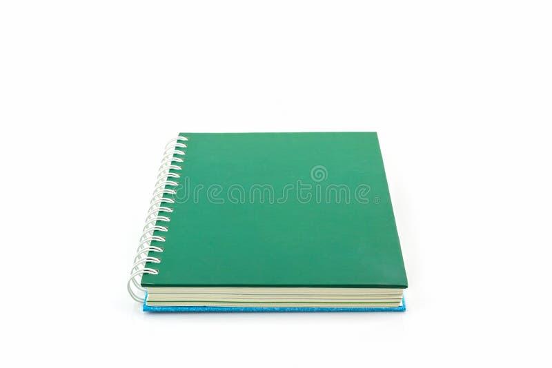 Groen spiraalvormig notitieboekje stock foto's