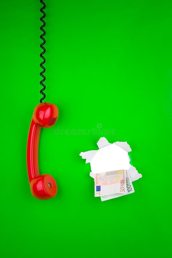 Groen telefoon en geld royalty-vrije stock fotografie