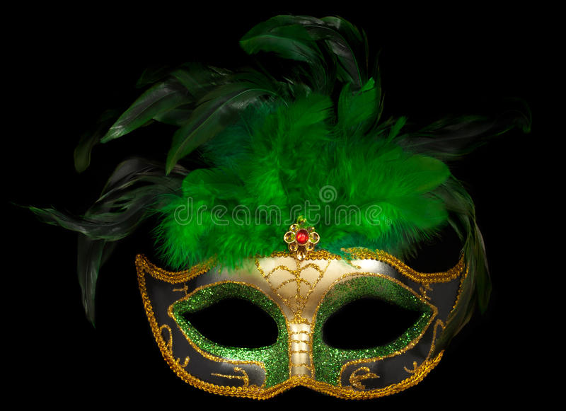Groen Venetiaans masker op zwarte stock foto