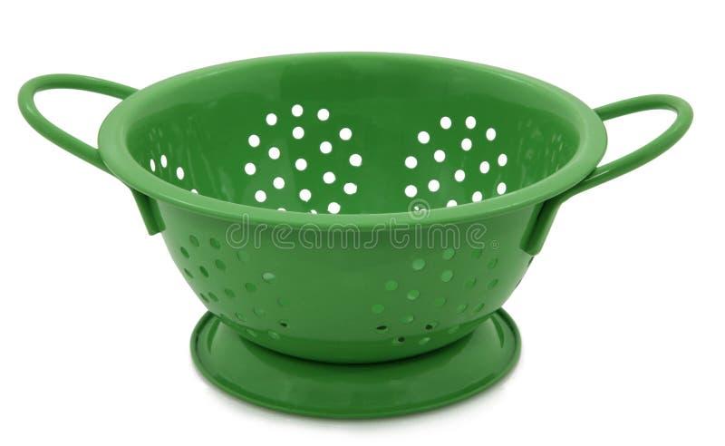 Groen Vergiet op Wit stock foto