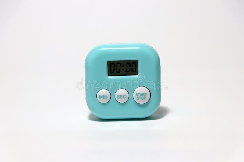 Groenachtig blauwe kleur van vierkante vorm plastic chronometer op de witte vloer royalty-vrije stock afbeelding