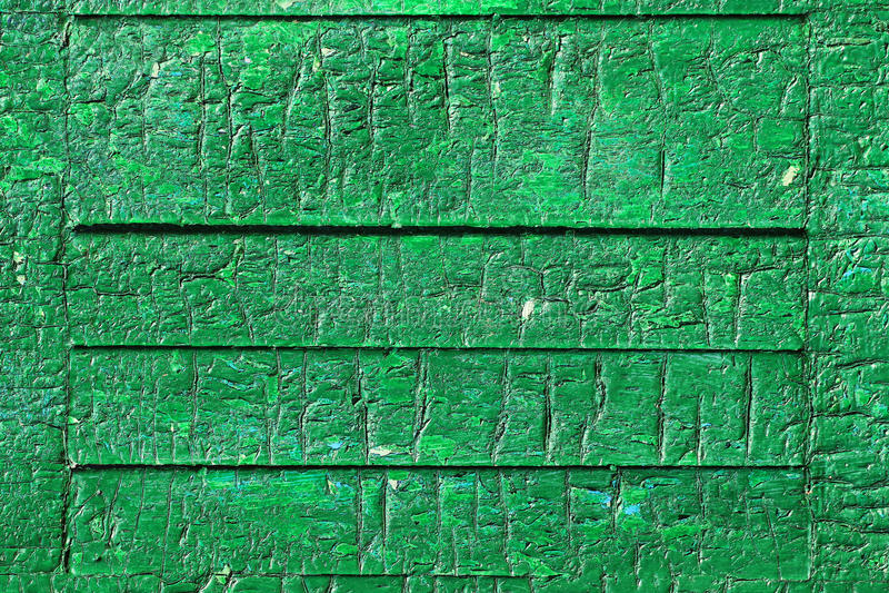 Groene afschilferende verf op oude houten raad royalty-vrije stock afbeelding