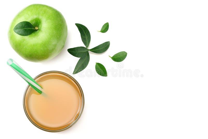 Groene appel met appelsap dat op witte achtergrond wordt geïsoleerd Hoogste mening royalty-vrije stock afbeeldingen