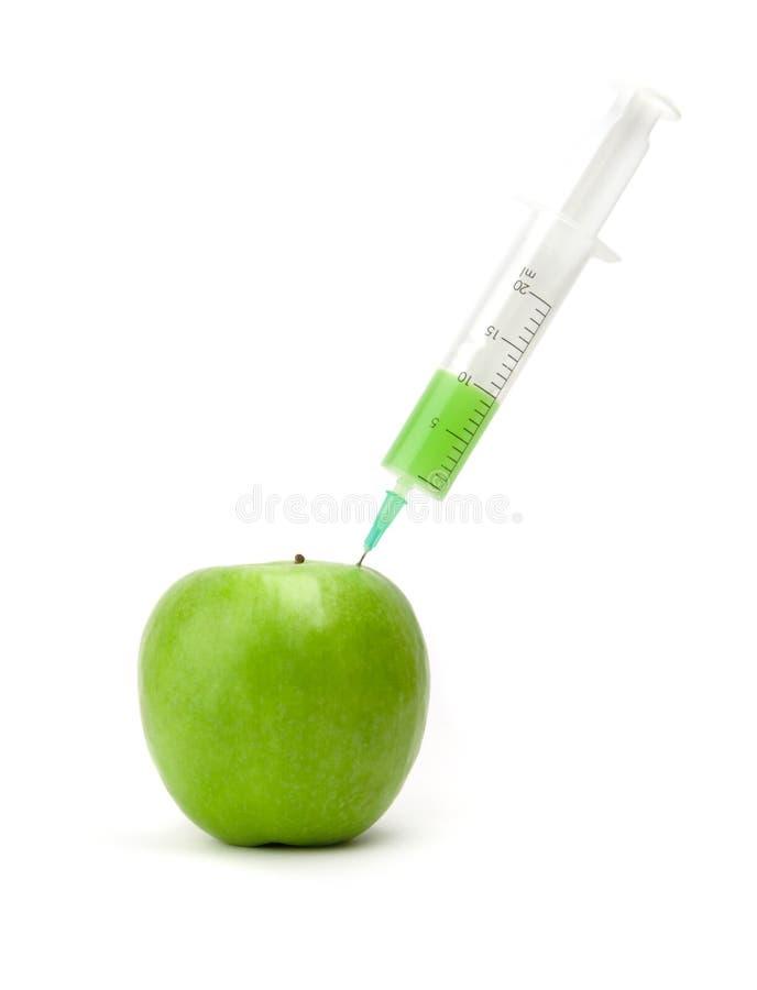 Groene appel met opgenomen spuit royalty-vrije stock afbeelding