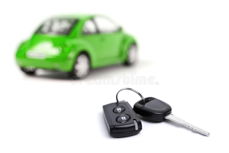 Groene auto en autosleutel royalty-vrije stock afbeeldingen