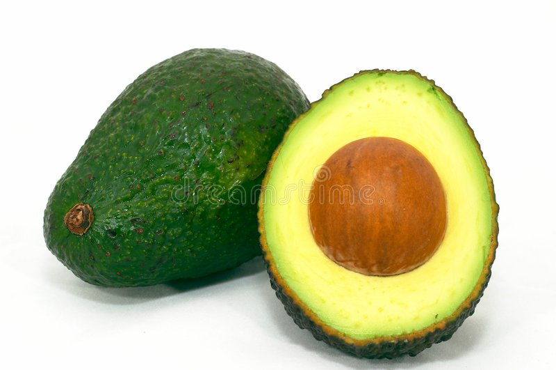 Groene Avocado en besnoeiingsavocado royalty-vrije stock afbeelding