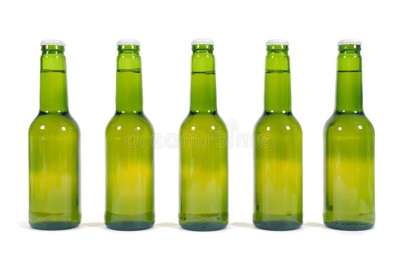 Groene bierflessen royalty-vrije stock afbeeldingen