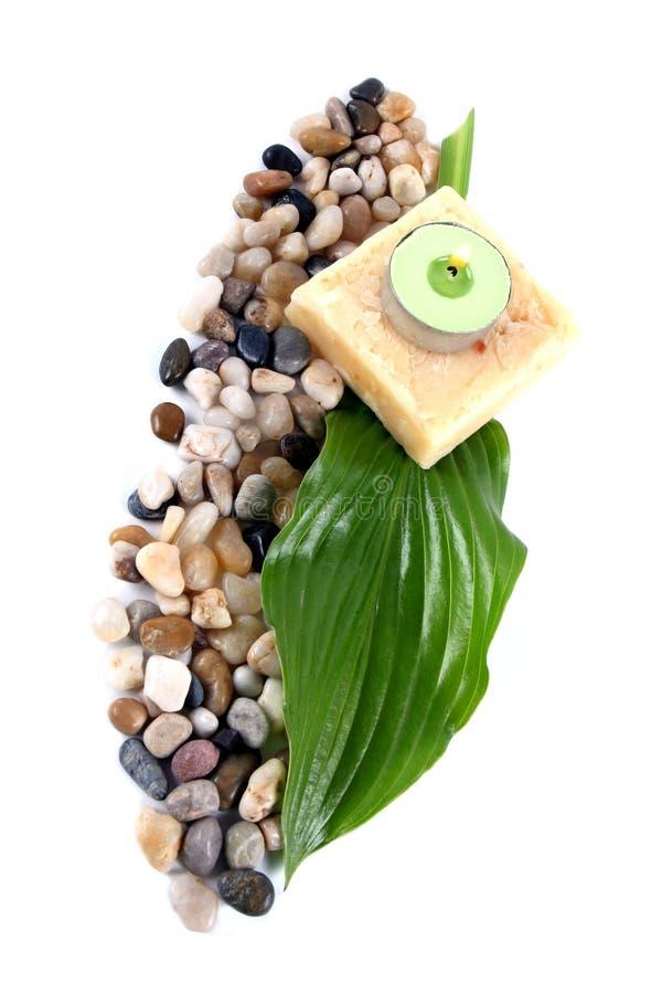 Groene blad, zeep en kaars stock afbeeldingen