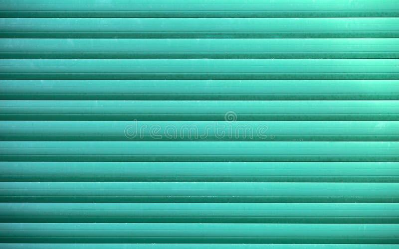 Groene blinddeur of de deur van de staalrol, metaalachtergrond royalty-vrije stock foto's