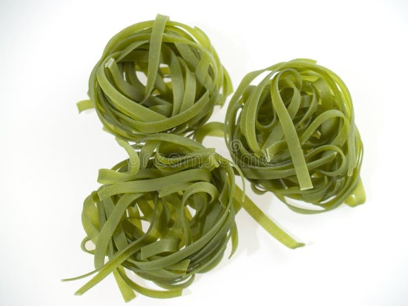 Groene deegwaren stock foto's