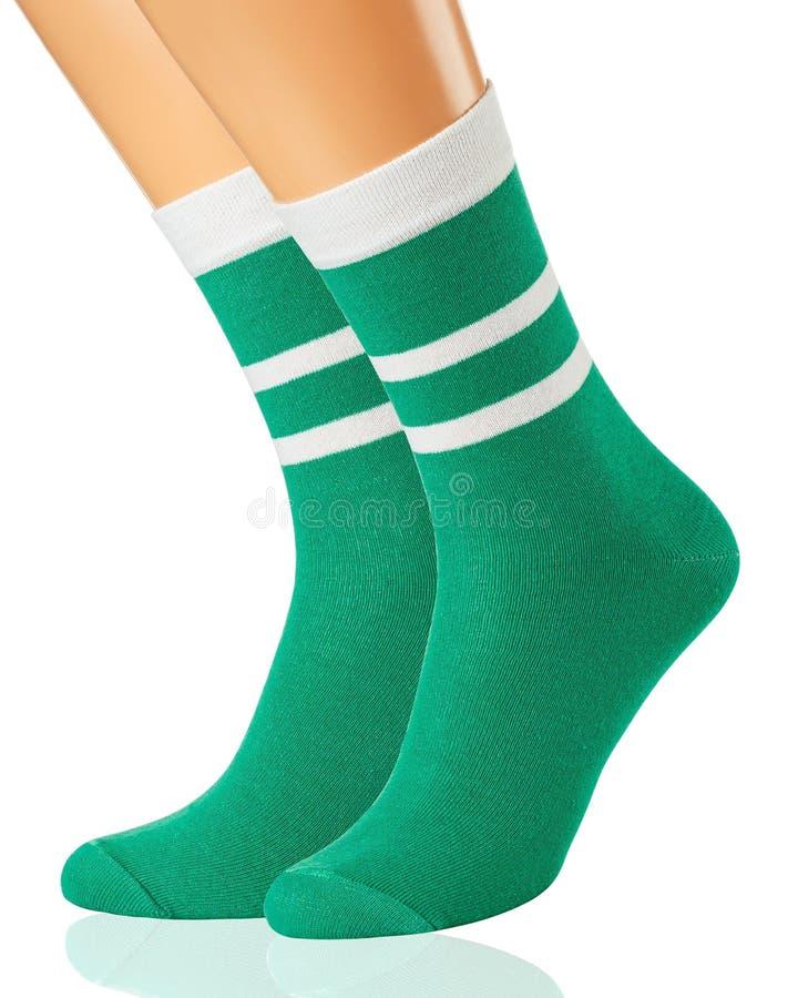 Groene die sokken op een ledenpop, op witte achtergrond wordt geïsoleerd royalty-vrije stock fotografie