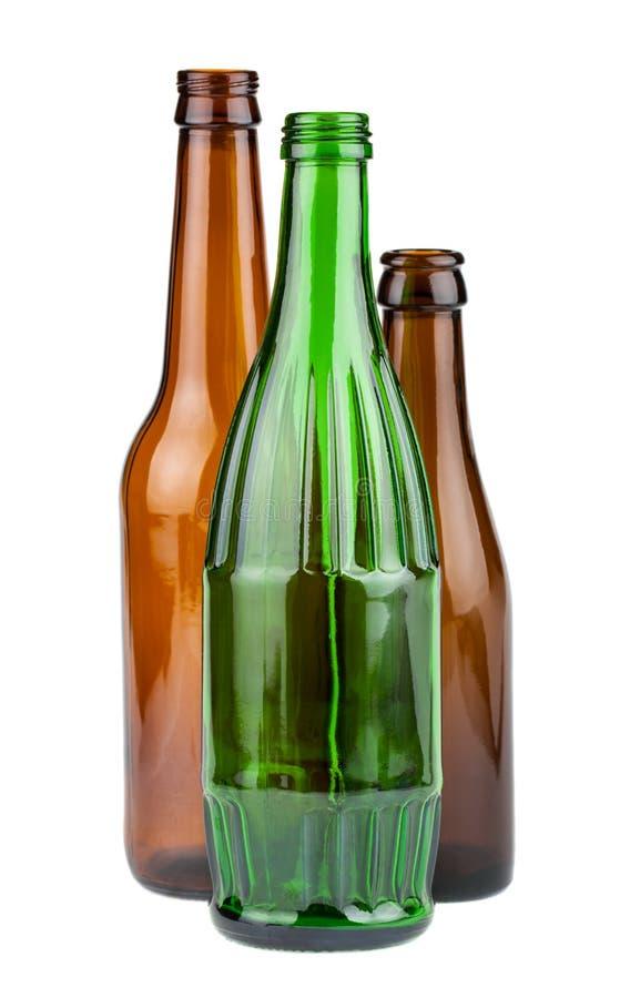 Groene en bruine lege flessen stock foto's