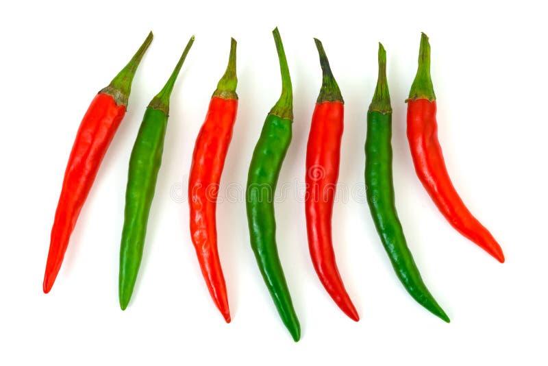Groene en roodgloeiende Spaanse peperpeper stock fotografie