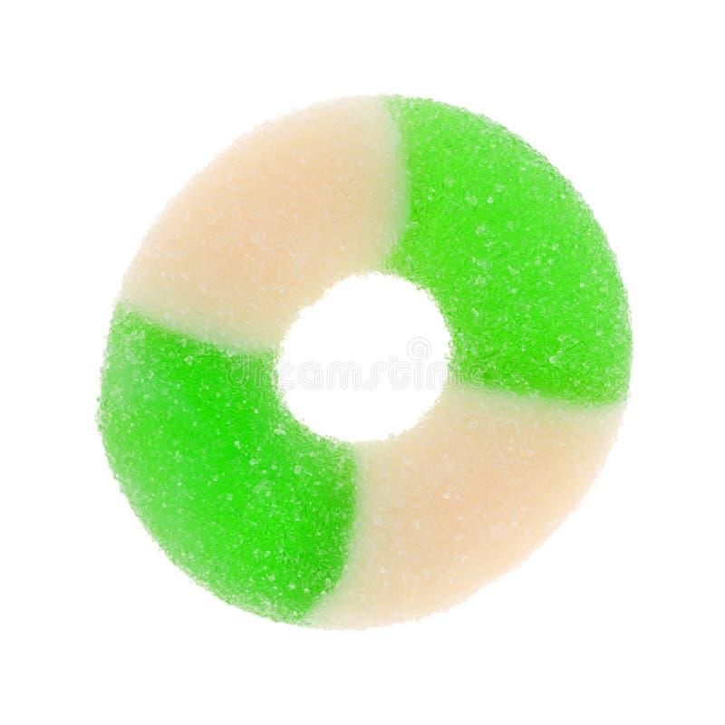 Groene en witte appel op smaak gebrachte suikergoedring op een witte achtergrond stock fotografie