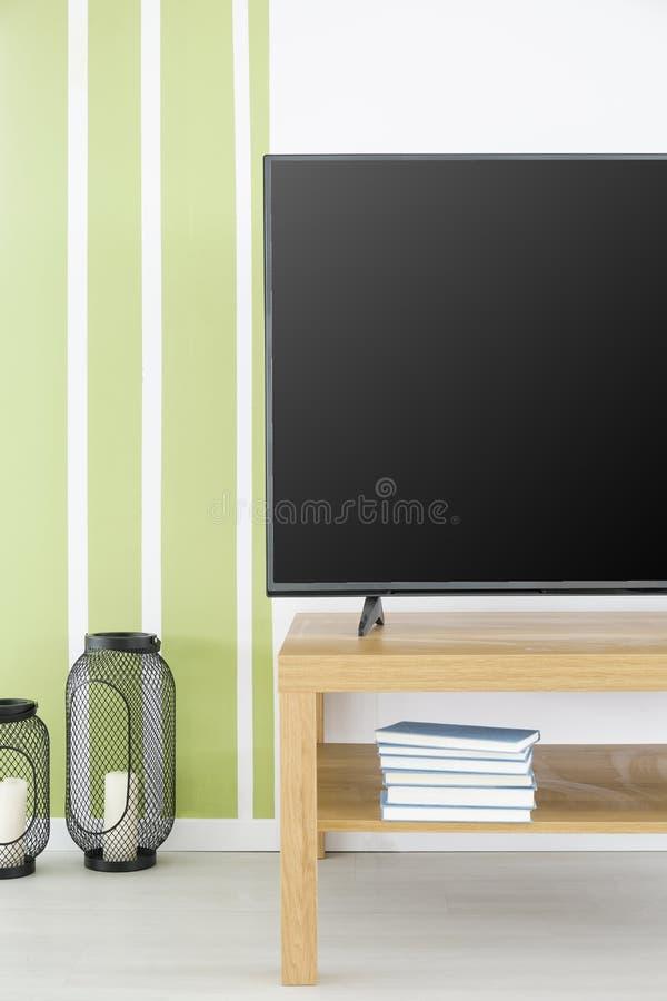 Groene en witte TV-ruimte stock fotografie