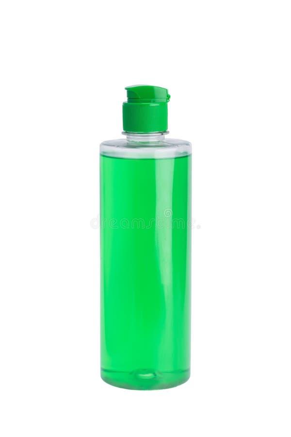 Groene fles met middelen om schoon te maken en desinfectie, geïsoleerd op wit stock afbeelding