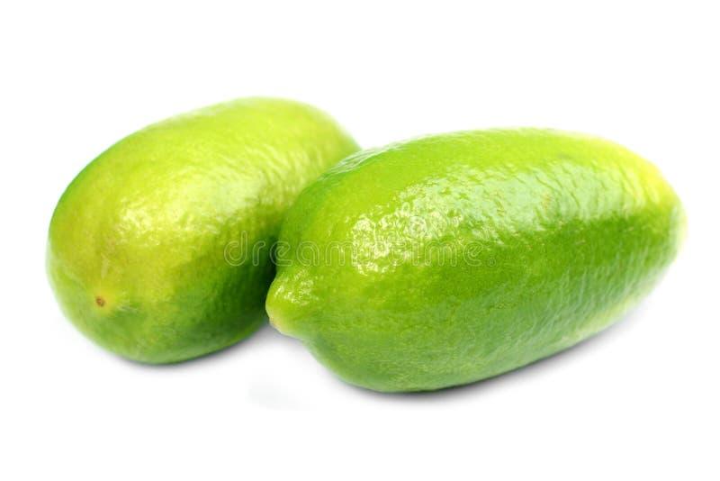 Groene geïsoleerde citroen stock foto's