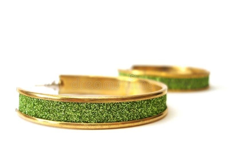 Groene geïsoleerdeo oorring royalty-vrije stock afbeelding