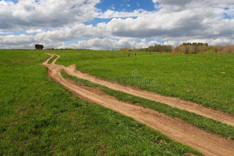 Groene gebied en weg aan overal. royalty-vrije stock afbeelding