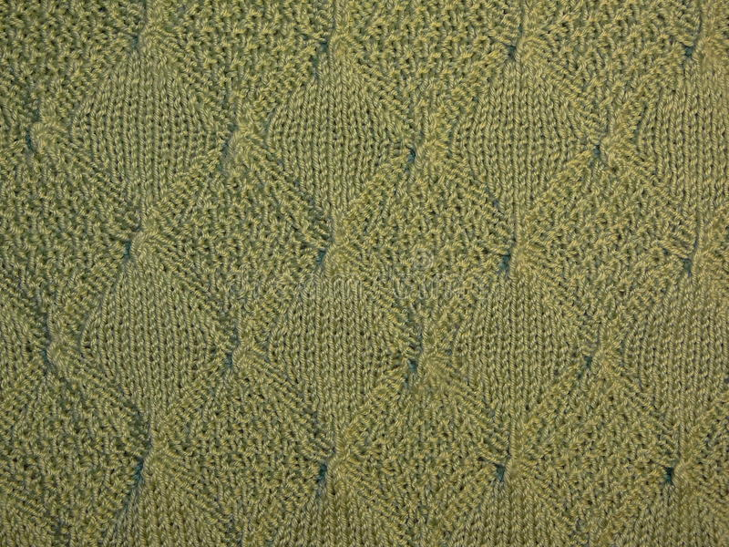 Groene gebreide stof stock afbeelding