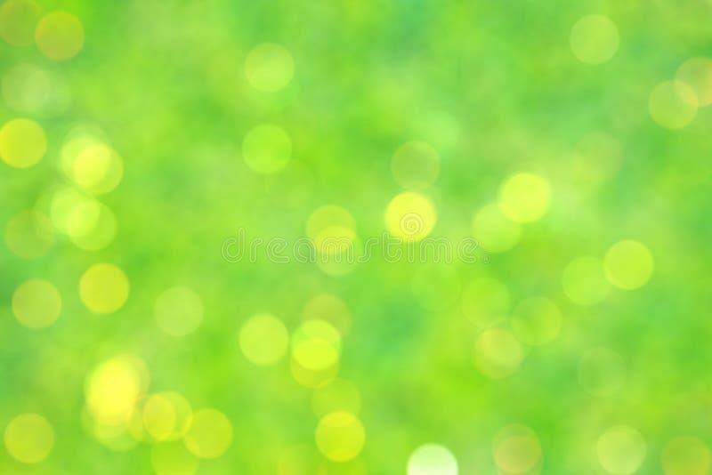 Groene gele bokehachtergrond royalty-vrije stock afbeeldingen