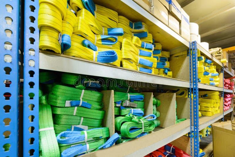 Groene, gele nylon zachte opheffende die slingers in stapels worden gestapeld stock fotografie