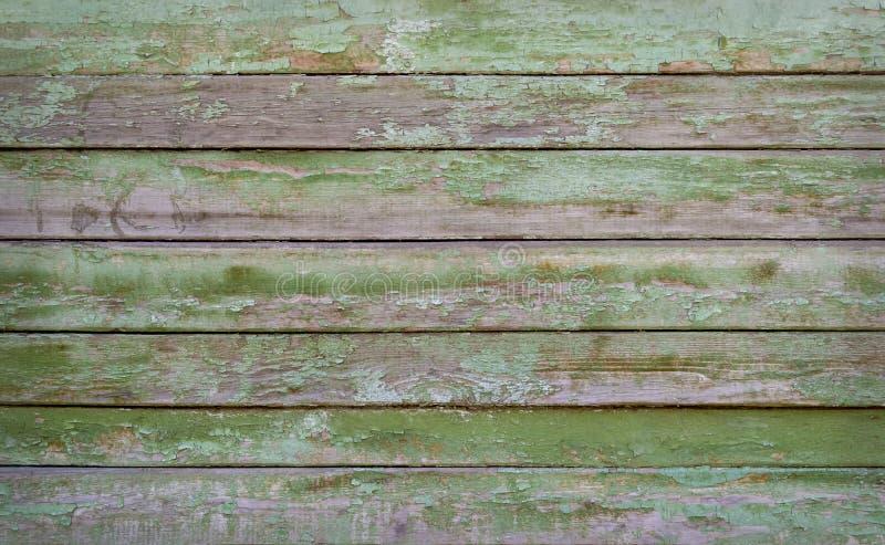 Groene geschilderde houten textuur als achtergrond close-up stock afbeeldingen