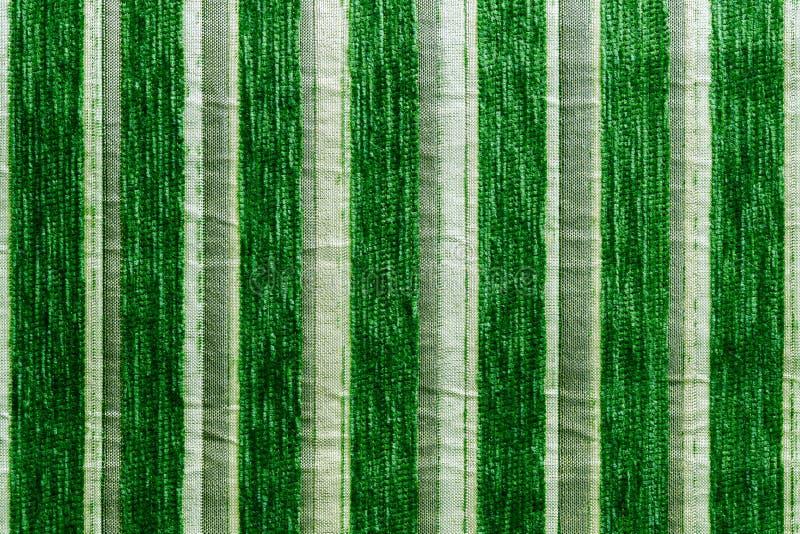 Groene gestreepte synthetische geweven het close-uptextuur en achtergrond van de stofferingsstof stock fotografie