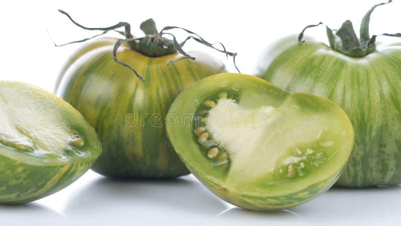 Groene Gestreepte tomaten stock fotografie