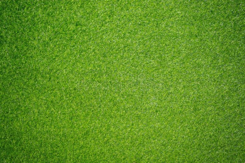 Groene grasachtergrond Kunstmatig gras voor achtergrond of behang stock foto