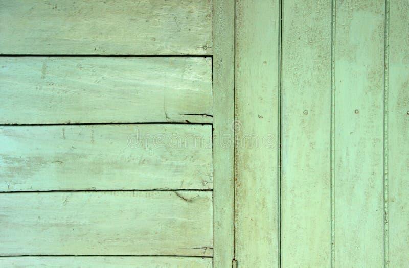 Groene houten muurachtergrond stock afbeelding