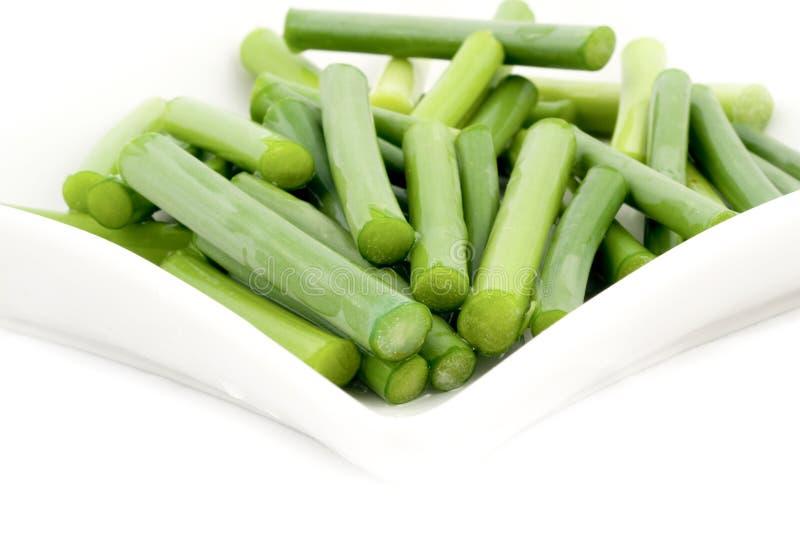 Groene knoflookstam stock afbeeldingen