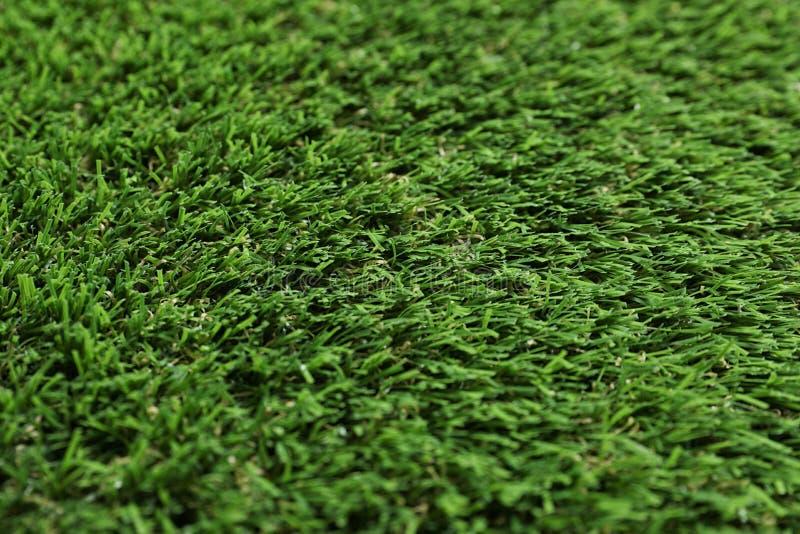 Groene kunstmatige grastextuur als achtergrond stock afbeelding