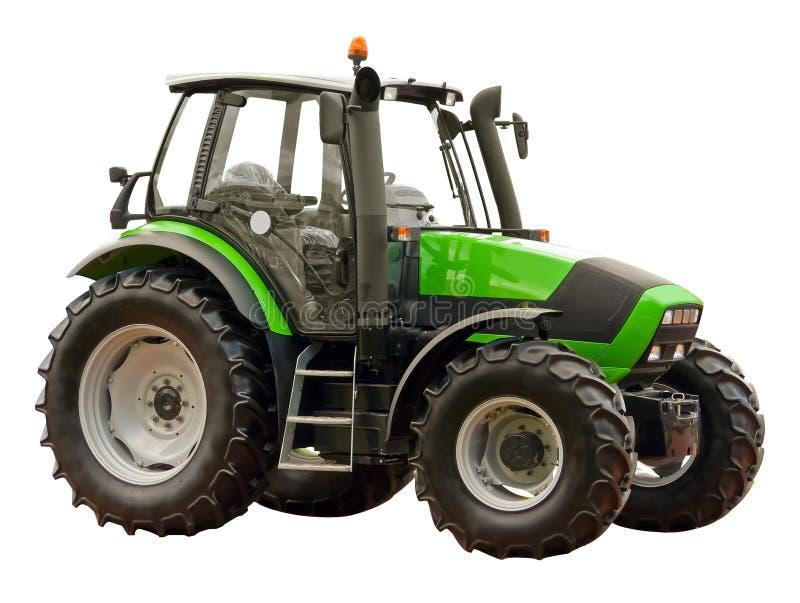Groene landbouwbedrijftractor stock foto's