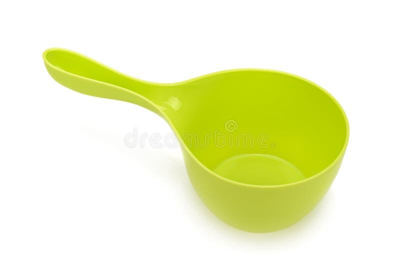 Groene lepel het water stock fotografie