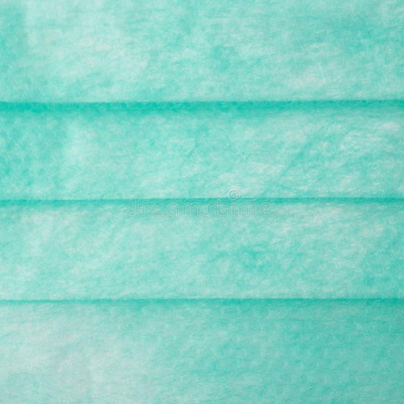 Groene medische chirurgische beschermende maskertextuur als abstracte achtergrond stock foto's