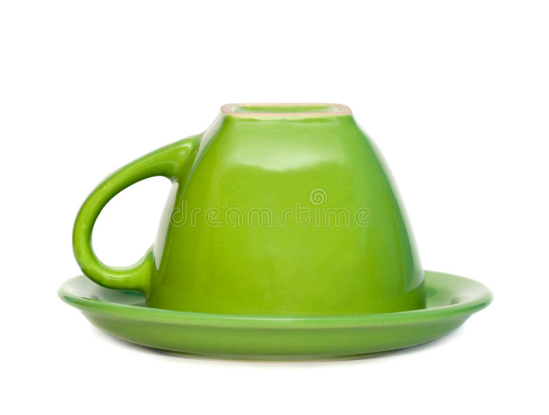 Groene omgekeerde kop op een schotel. stock afbeelding