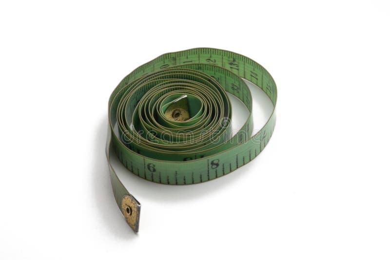 Groene oude en gebruikte metende band van de kleermaker royalty-vrije stock afbeeldingen