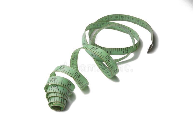 Groene oude en gebruikte metende band van de kleermaker stock foto's